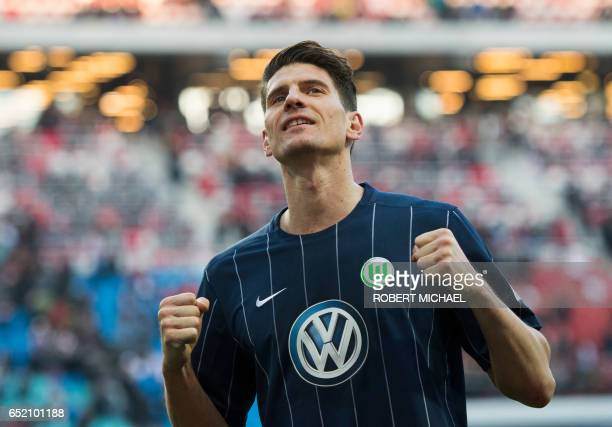 Wolfsburg's forward Mario Gomez celebrates after the German First division Bundesliga football match of RB Leipzig vs VfL Wolfsburg in Leipzig...