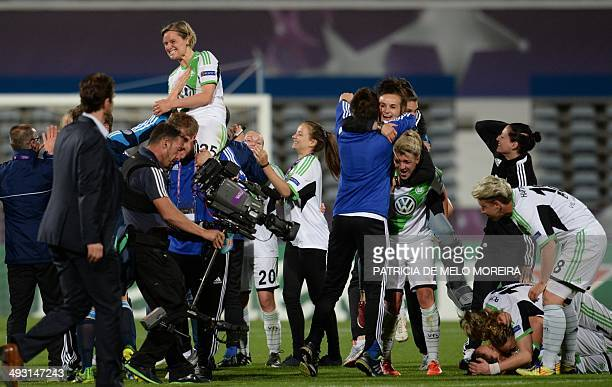 Wolfsburg's forward Martina Mueller celebrates with teammates their 43 victory over Tyreso at the end of the UEFA Women's Champions League final...