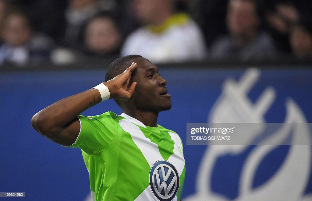 Wolfsburg's French midfielder <a gi-track='captionPersonalityLinkClicked' href=/galleries/search?phrase=Josuha+Guilavogui&family=editorial&specificpeople=6722161 ng-click='$event.stopPropagation()'>Josuha Guilavogui</a> reacts after scoring during the German first division Bundesliga football match Hamburger SV vs VfL Wolfsburg in Hamburg, northern Germany, on April 11, 2015. AFP PHOTO / TOBIAS SCHWARZ