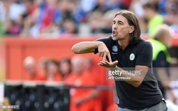Wolfsburg's head coach Martin Schmidt gestures during the German first division Bundesliga football match Bayer Leverkusen vs VfL Wolfsburg in...