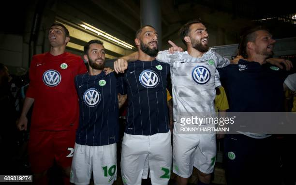 Wolfsburg's Koen Casteels Yunus Malli Ashkan Dejagah and Borja Mayoral Moay celebrate after German Bundesliga relegation second leg football match...