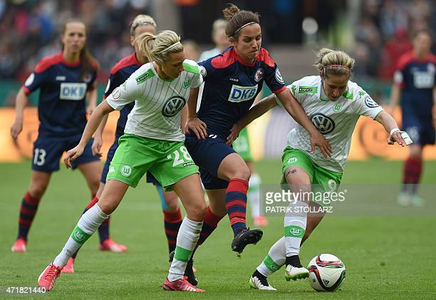 Wolfsburg's Lena Goessling and Anna Blaesse vie with Potsdam's Natasa Andonova during the Women's German Cup DFB Pokal final football match between...