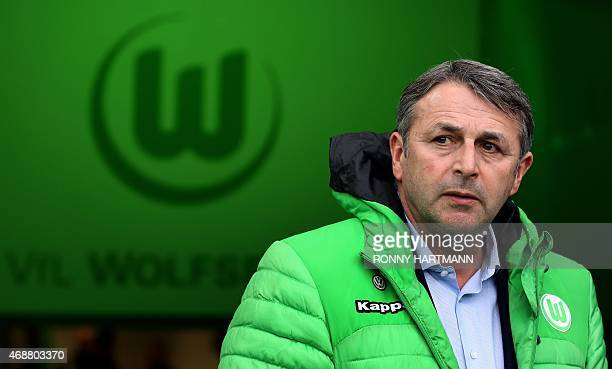 Wolfsburg's manager Klaus Allofs looks on ahead of the German Football Cup DFB Pokal quarterfinal football match between VfL Wolfsburg and SC...