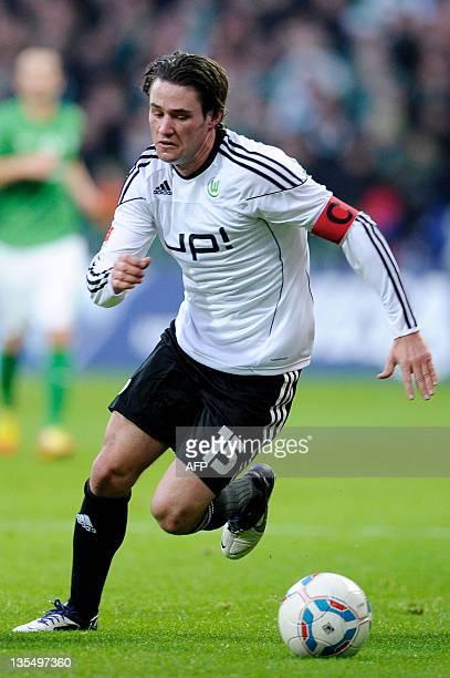 Wolfsburg's midfielder Christian Traesch plays the ball during the German first division Bundesliga football match SV Werder Bremen vs VfL Wolfsburg...