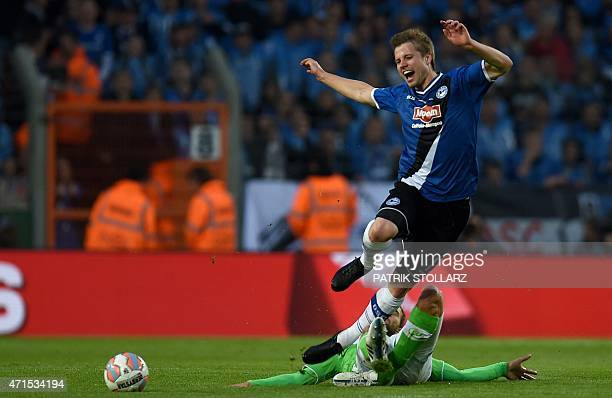 Wolfsburg's midfielder Daniel Caligiuri and Bielefeld`s Julian Boerner vie for the ball during the German Cup DFB Pokal semifinal football match...