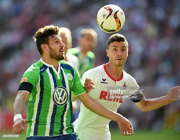 Wolfsburg's midfielder Daniel Caligiuri and Cologne's defender Jonas Hector vie for the ball during the German first division Bundesliga football...