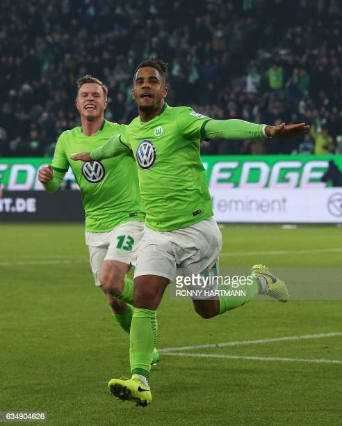 Wolfsburg's midfielder Daniel Didavi celebrates after scoring his team's second goal with Wolfsburg's midfielder Yannick Gerhardt during the German...