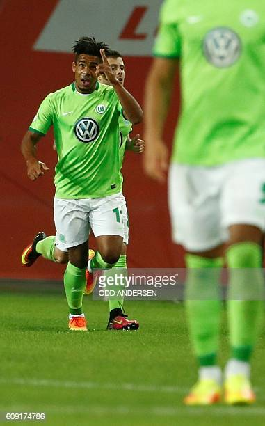 Wolfsburg's midfielder Daniel Didavi celebrates during the German first division Bundesliga football match between VfL Wolfsburg and Borussia...