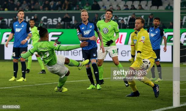 Wolfsburg's midfielder Daniel Didavi of Wolfsburg scores his team's second goal against Oliver Hoffenheim's goalkeeper Oliver Baumann during the...