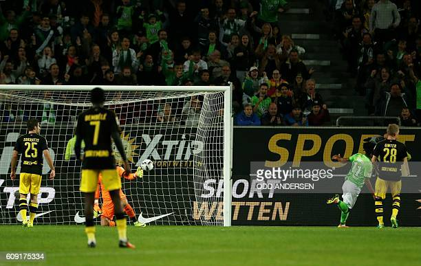 Wolfsburg's midfielder Daniel Didavi scores during the German first division Bundesliga football match between VfL Wolfsburg and Borussia Dortmund at...