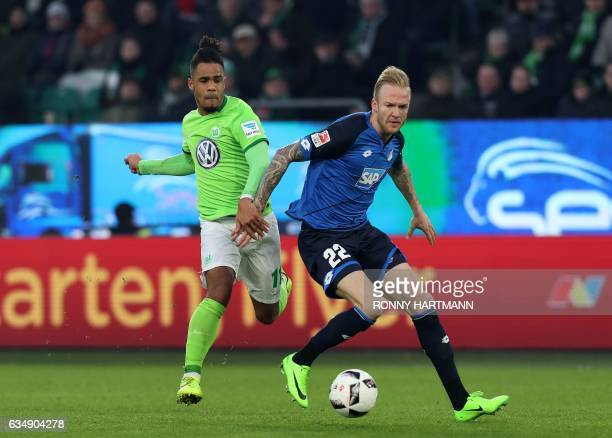 Wolfsburg's midfielder Daniel Didavi vies with Hoffenheim's midfielder Kevin Vogt during the German First division Bundesliga football match between...