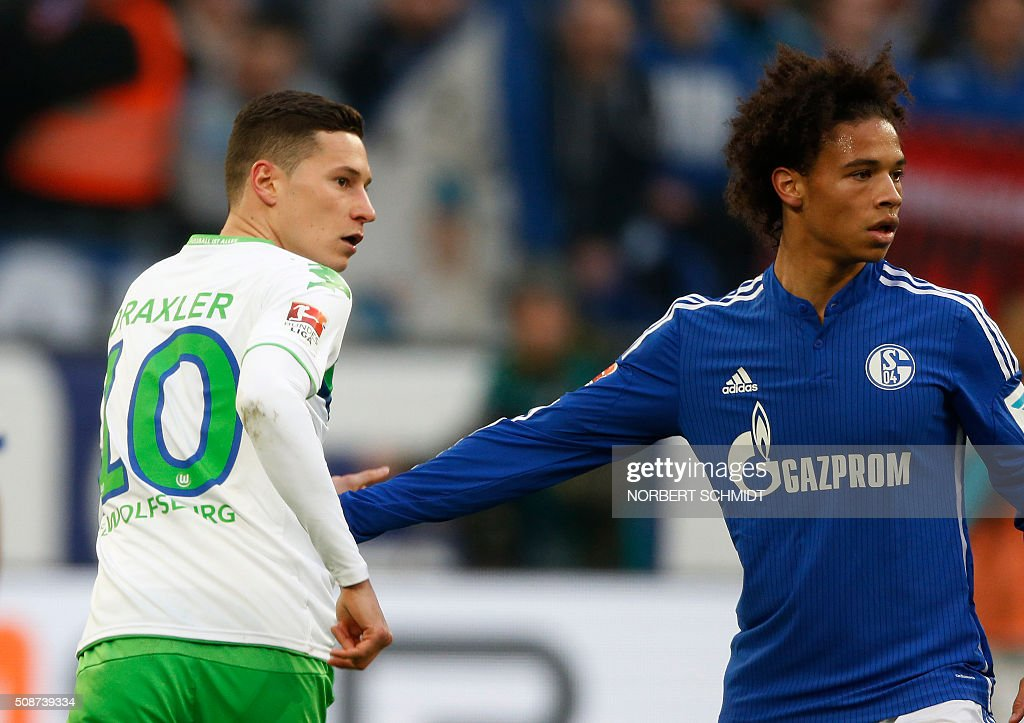 Wolfsburg's midfielder Julian Draxler (L) and Schalke's midfielder Leroy Sane vie for the ball during the German Bundesliga first division football match FC Schalke 04 v Wolfsburg in Gelsenkirchen, western Germany on February 6, 2016. / AFP / NORBERT SCHMIDT /