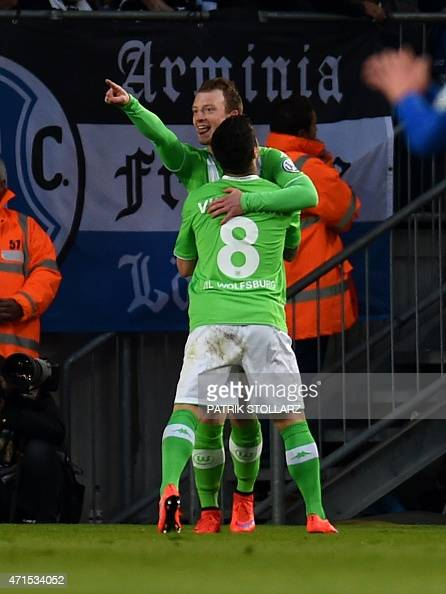 Wolfsburg's midfielder Maximilian Arnold and his teammate Portuguese striker Vieirinha celebrate after scoring 01 during the German Cup DFB Pokal...
