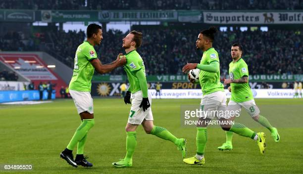 Wolfsburg's midfielder Maximilian Arnold celebrates after scoring his team's first goal with Wolfsburg's Brazilian midfielder Luiz Gustavo...