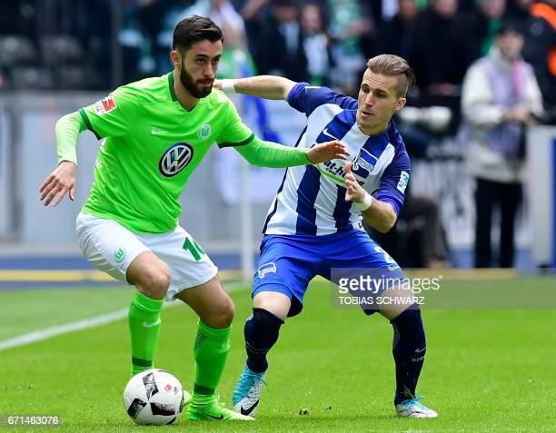 Wolfsburg's midfielder Yunus Malli and Berlin's Slovakian defender Peter Pekarík vie for the ball during the German First division Bundesliga...