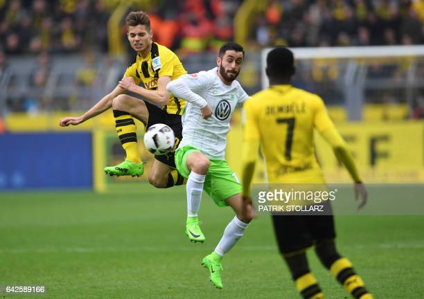 Wolfsburg's midfielder Yunus Malli and Dortmund's Spanish defender Marc Bartra vie for the ball vie for the ball during the German First division...