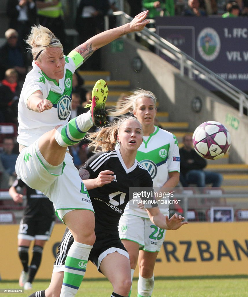 Wolfsburg's Nilla Fischer (L) and Frankfurter's Jackie Groenen vie for the ball during the women's Champions League, semi-final second leg football match 1 FFC Frankfurt v VfL Wolfsburg in Frankfurt am Main, western Germany on May 1, 2016. / AFP / dpa / Frank Rumpenhorst / Germany OUT