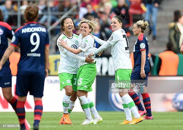 Wolfsburg´s players celebrate after defeating Potsdam's players 30 in the Women's German Cup DFB Pokal final football match between Turbine Potsdam...