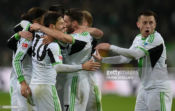 Wolfsburg's players celebrate scoring 10 during the German first division Bundesliga football match VfL Wolfsburg vs VfB Stuttgart in the German city...