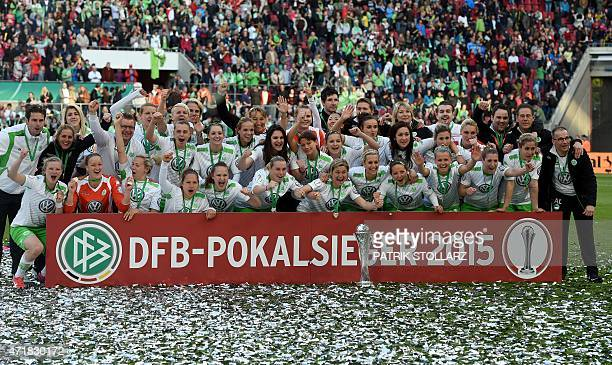 Wolfsburg's players pose for a group photo as they celebrate after defeating Potsdam's players 30 in the Women's German Cup DFB Pokal final football...