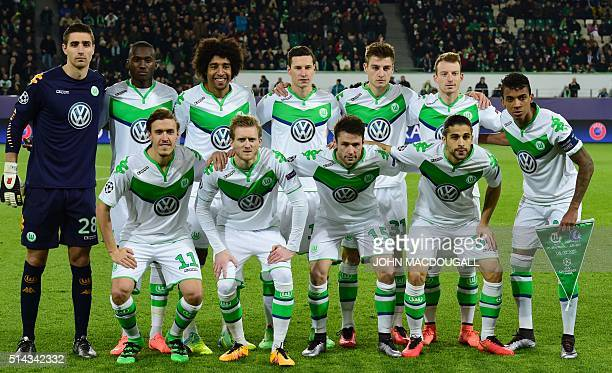 Wolfsburg's players pose for a team picture prior to the secondleg round of 16 UEFA Champions league football match between VfL Wolfsburg and KAA...