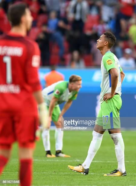 Wolfsburg´s players react after the German first division Bundesliga football match Bayer Leverkusen vs VfL Wolfsburg in Leverkusen western Germany...
