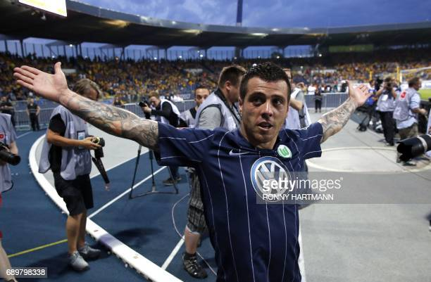 Wolfsburg's Portuguese midfielder Vieirinha celebrates after scoring during German Bundesliga relegation second leg football match between Eintracht...