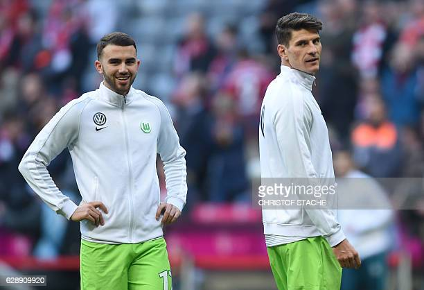 Wolfsburg's Spanish forward Borja Mayoral and Wolfsburg's forward Mario Gomez smile during the warmup prior to the German first division Bundesliga...