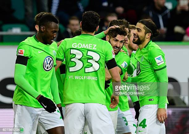 Wolfsburg's Spanish forward Borja Mayoral celebrates with his teammates after scoring during the German first division Bundesliga football match...