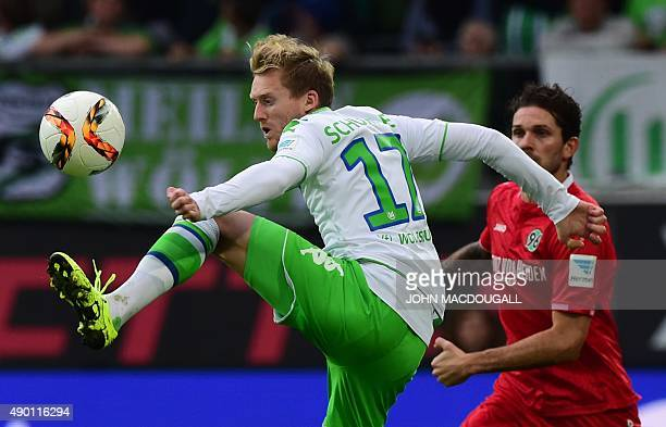 Wolfsburg's striker Andre Schuerrle vies with Hanover's Danish midfielder Leon Andreasen vie for the ball during the German first division Bundesliga...