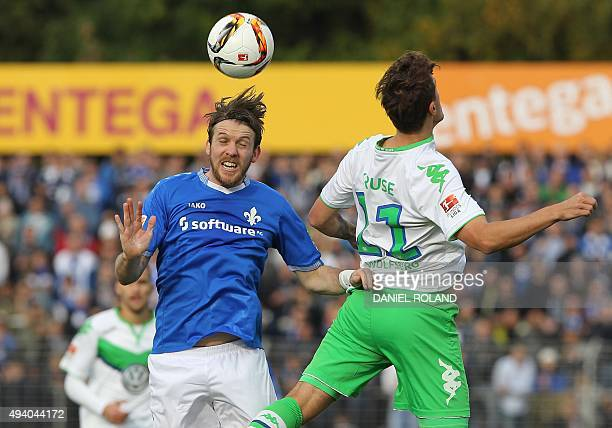 Wolfsburg's striker Max Kruse and Darmstadt's midfielder Peter Niemeyer vie for the ball during the German first division Bundesliga football match...