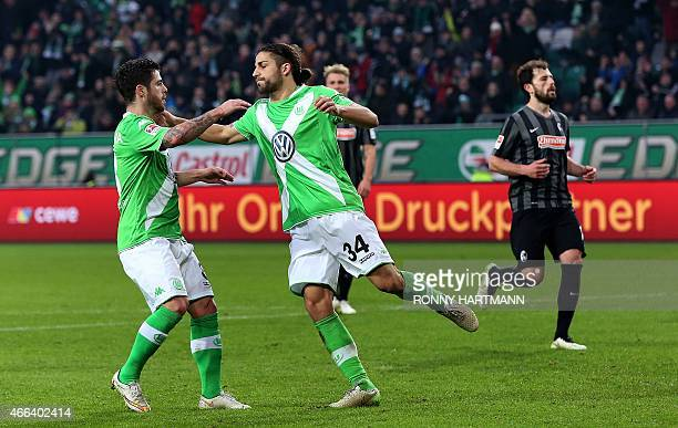 Wolfsburg's Swiss defender Ricardo Rodriguez and Wolfsburg's Portuguese striker Vieirinha celebrate after Rodriguez scored 20 during the German first...