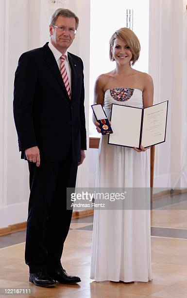 Wolke Hegenbarth receives the Federal Cross of Merit from German President Christian Wulff at Bellevue Castle on August 26 2011 in Berlin Germany