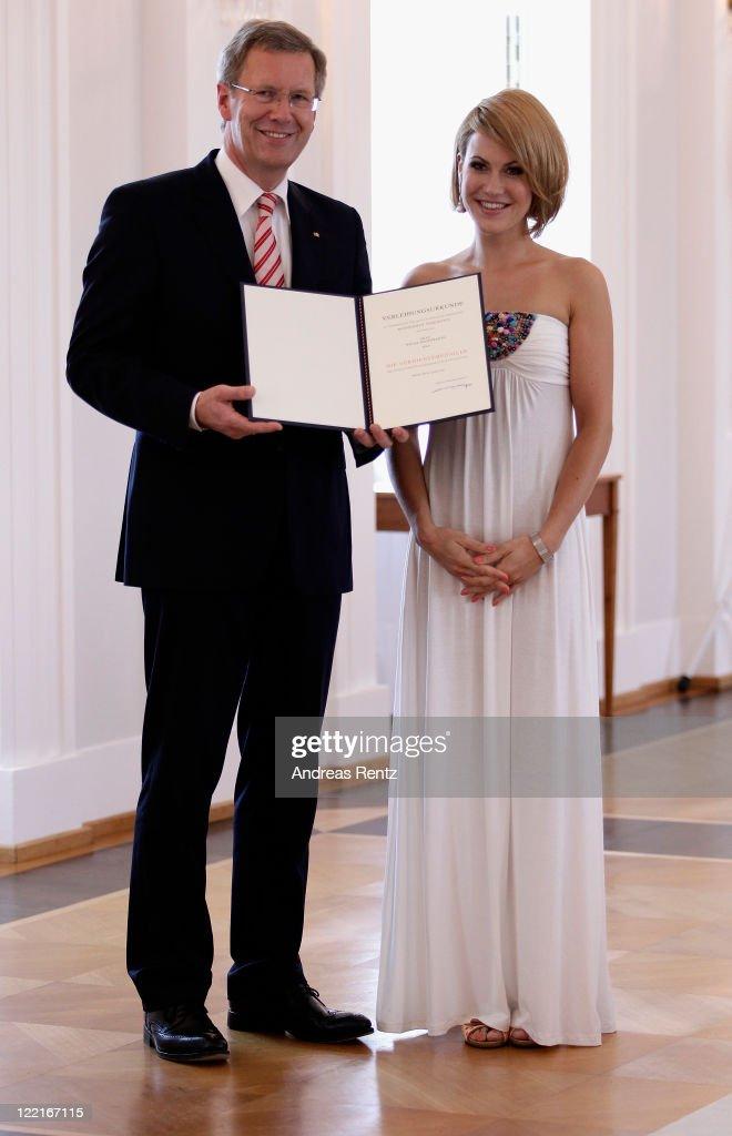 Wolke Hegenbarth receives the Federal Cross of Merit from German President Christian Wulff at Bellevue Castle on August 26 2011 in Berlin Germany