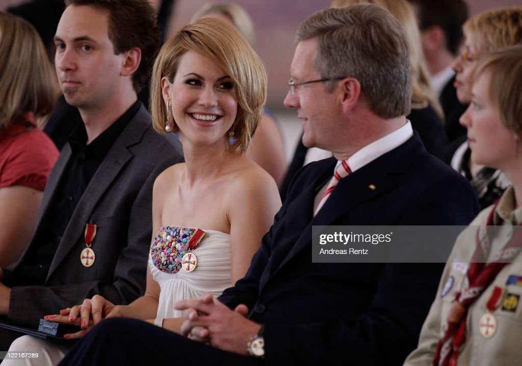<a gi-track='captionPersonalityLinkClicked' href=/galleries/search?phrase=Wolke+Hegenbarth&family=editorial&specificpeople=624199 ng-click='$event.stopPropagation()'>Wolke Hegenbarth</a> smiles to German President <a gi-track='captionPersonalityLinkClicked' href=/galleries/search?phrase=Christian+Wulff&family=editorial&specificpeople=221618 ng-click='$event.stopPropagation()'>Christian Wulff</a> after she received the Federal Cross of Merit (Bundesverdienstkreuz) by Wulff at Bellevue Castle on August 26, 2011 in Berlin, Germany.