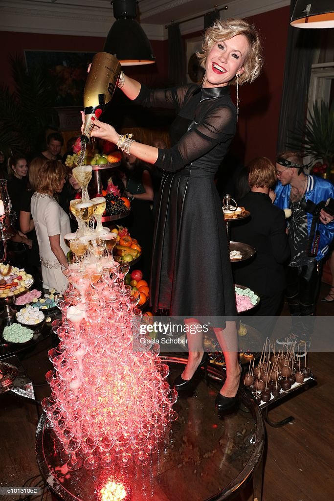 <a gi-track='captionPersonalityLinkClicked' href=/galleries/search?phrase=Wolke+Hegenbarth&family=editorial&specificpeople=624199 ng-click='$event.stopPropagation()'>Wolke Hegenbarth</a> with champagne during the Bild 'Place to B' Party at Borchardt during the 66th Berlinale International Film Festival Berlin on February 13, 2016 in Berlin, Germany.