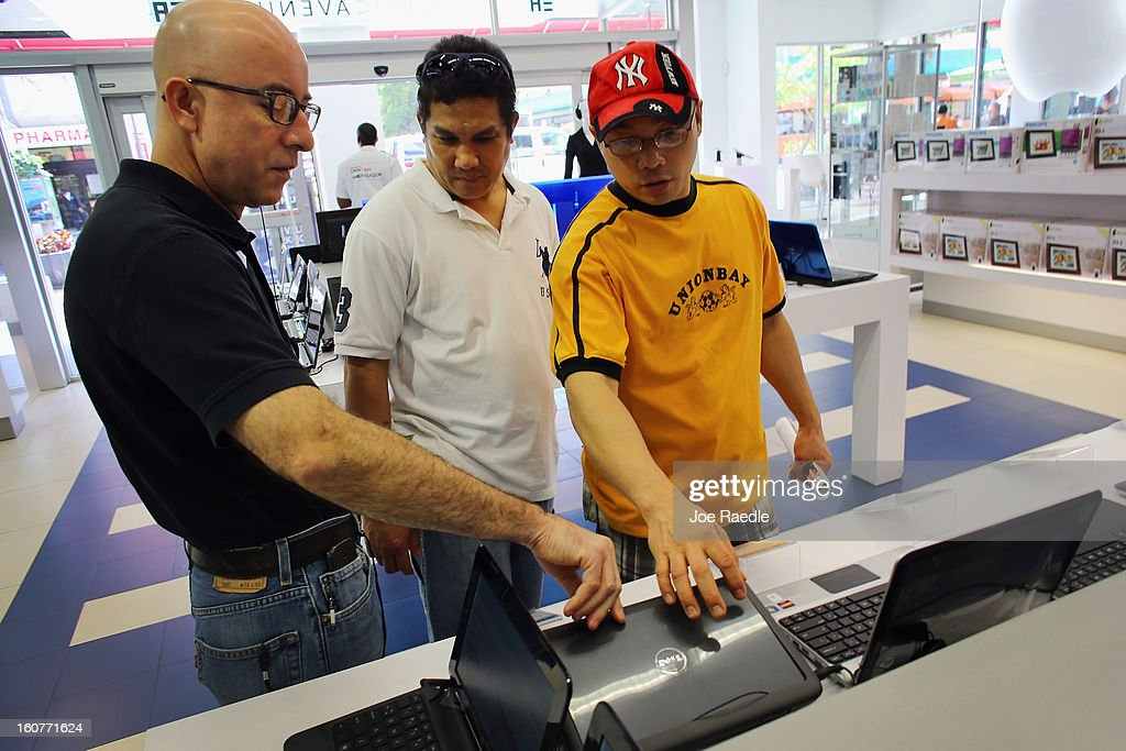 Wolmer Santiago shows a Dell computer to Francis Valis (C) and Ariel Labella display at the Electric Avenue store on February 5, 2013 in Miami, Florida. Dell Inc. today announced it will be taken private in a deal valued at about $24.4 billion. The company will be acquired by Dell founder and Chief Executive Michael S. Dell and global technology investment firm Silver Lake and Microsoft Corp. will invest $2 billion in the deal.