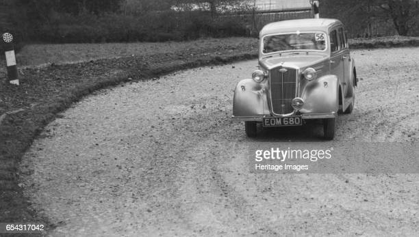 Wolseley saloon of BW Fursdon competing in the RAC Rally 1939 Artist Bill Brunell Wolseley Saloon 1140 cc Vehicle Reg No EOM680 Event Entry No 56...