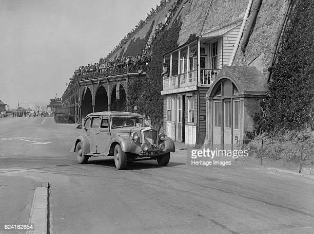 Wolseley saloon of HB Brownright and HE Symons on Madeira Drive Brighton RAC Rally 1939 Artist Bill BrunellWolseley Saloon 18 hp Vehicle Reg No...