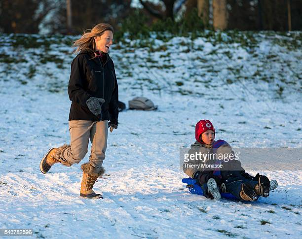 WoluweSaintPierre Brussels Kingdom of Belgium January 16 2013 People enjoy snow in a park of Brussels