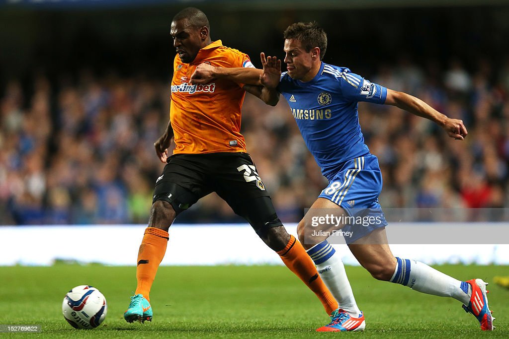Wolverhampton Wanderer' <a gi-track='captionPersonalityLinkClicked' href=/galleries/search?phrase=Ronald+Zubar&family=editorial&specificpeople=1295892 ng-click='$event.stopPropagation()'>Ronald Zubar</a> and Chelsea's Cesar Azpilicueta compete for the ball during the Capital One Cup third round match between Chelsea and Wolverhampton Wanderers at Stamford Bridge on September 25, 2012 in London, England.
