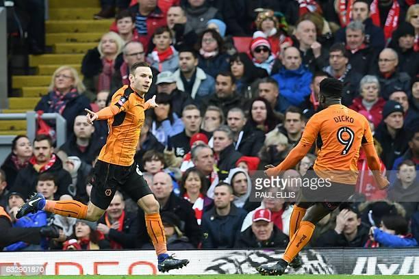 Wolverhampton Wanderers' Austrian striker Andreas Weimann celebrates scoring his team's second goal with Wolverhampton Wanderers' Malian striker...