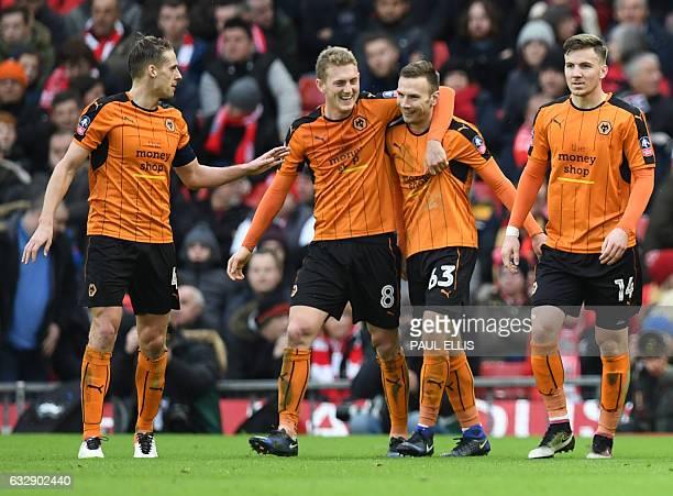 Wolverhampton Wanderers' Austrian striker Andreas Weimann celebrates scoring his team's second goal with Wolverhampton Wanderers' English midfielder...