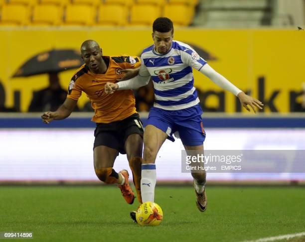 Wolverhampton Wanderers' Benik Afobe and Reading's Michael Hector battle for the ball
