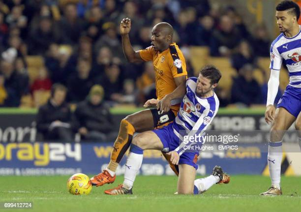Wolverhampton Wanderers' Benik Afobe is tackled by Reading's Oliver Norwood