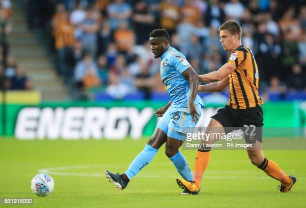 Wolverhampton Wanderers' Bright Enobakhare and Hull City's Markus Henriksen battle for the ball during the Sky Bet Championship match at the KCOM...