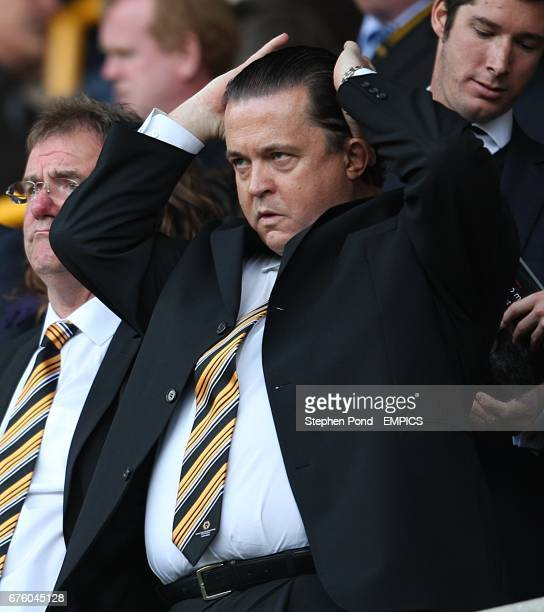 Wolverhampton Wanderers Chief Executive Jez Moxey fixes his hair in the stands
