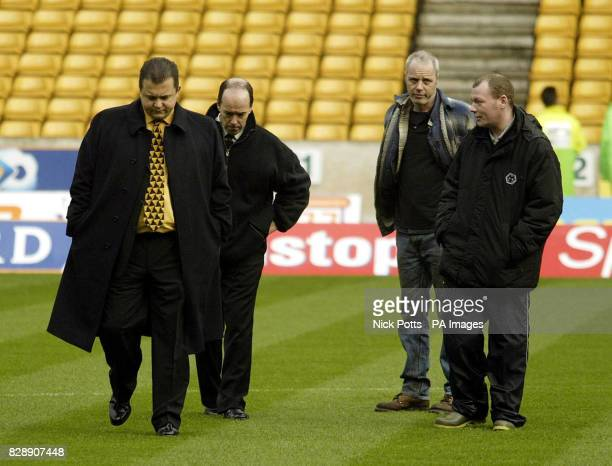 Wolverhampton Wanderers' Chief Executive Jez Moxey with club Secretary Richard Skirrow walks the around the pitch with groundstaff after the Wolves v...