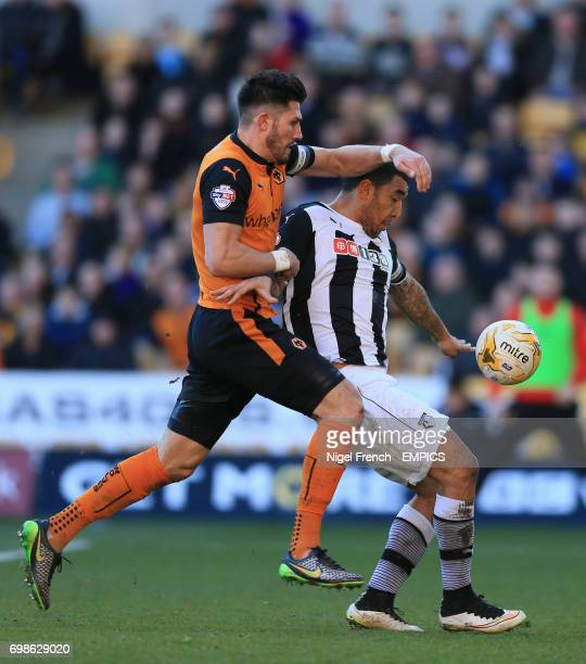 Wolverhampton Wanderers' Danny Batth and Watford's Troy Deeney battle for the ball