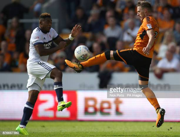 Wolverhampton Wanderers' David Edwards and Middlesbrough's Britt Assombalonga battle for the ball during the Sky Bet Championship match at Molineux...